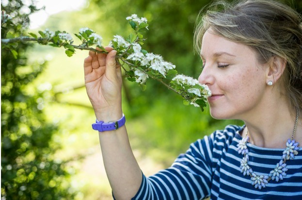 Woman smells wild flowers ©Matthew Roberts