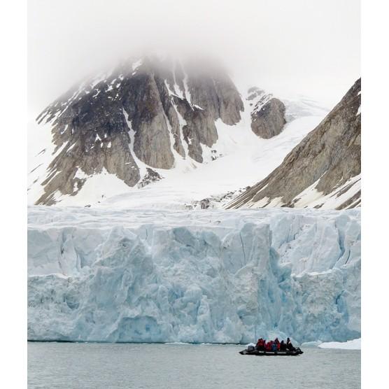 Guests in Zodiac with glacier face. © Rob Jordan/Heatherlea