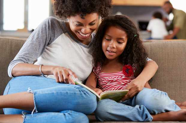 Mother and daughter reading. © Monkey Business Images/Getty