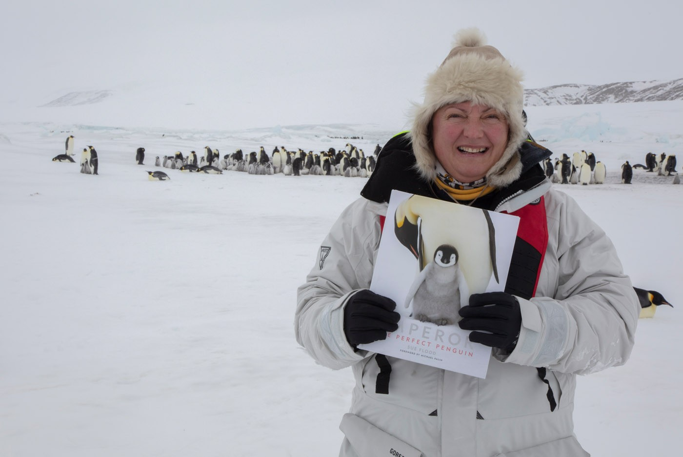 Sue with book and penguins
