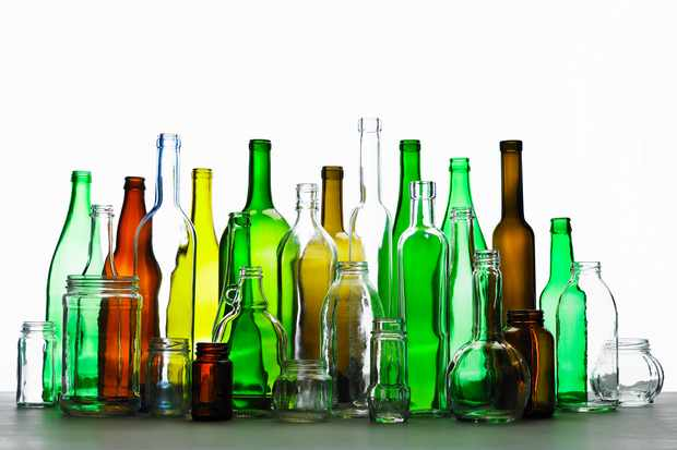 Coloured bottles and jars. © Ryan McVay/Getty