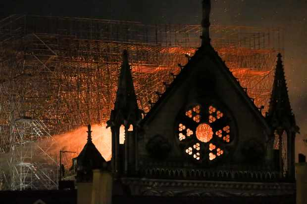 Flames and smoke are seen billowing from the roof at Notre-Dame Cathedral. © Michel Stoupak/NurPhoto/ Getty