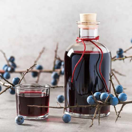 Why not give a handmade gift this year, perhaps using foraged fruit, such as this sloe port. Oksana Schmidt/Getty.