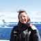 Dr Tara Shine climate expert stands in a glacial landscape