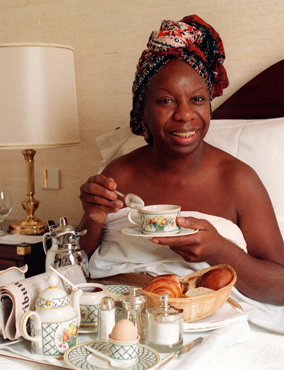 (FILES) Picture dated 20 July 1988 of legendary jazz and blues singer Nina Simone taking her breakfast at a Juan-Les-Pins hotel during the Jazz festival in the French southern Riviera town. Simone died 21 April 2003 at the age of 70 ather home in southern France, said her manager in a statement. AFP PHOTO Michel GANGNE        (Photo credit should read MICHEL GANGNE/AFP via Getty Images)