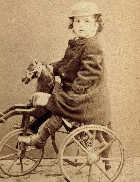UNSPECIFIED - JULY 07: Claude Debussy (Saint-Germain-en-Laye, 1862-Paris, 1918), French composer and pianist, seen here as a child on a tricycle, April 15, 1867. Saint-Germain-En-Laye, Musée Claude Debussy (Debussy Museum) (Photo by DeAgostini/Getty Images)