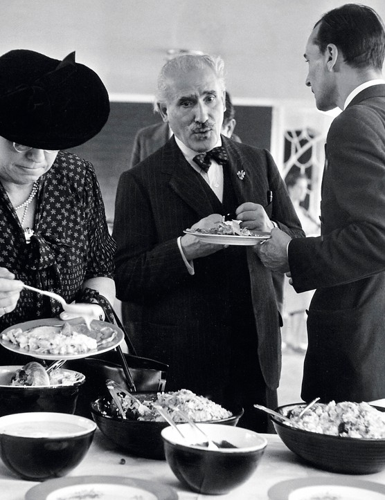 Conductor Arturo Toscanini (C) enjoying buffet lunch at poolside at the Arrowhead Springs Hotel.  (Photo by Herbert Gehr/The LIFE Images Collection via Getty Images/Getty Images)