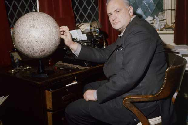 Patrick Moore pictured at his house in Selsey with a globe of the Moon. (Photo by Keystone/Getty Images)