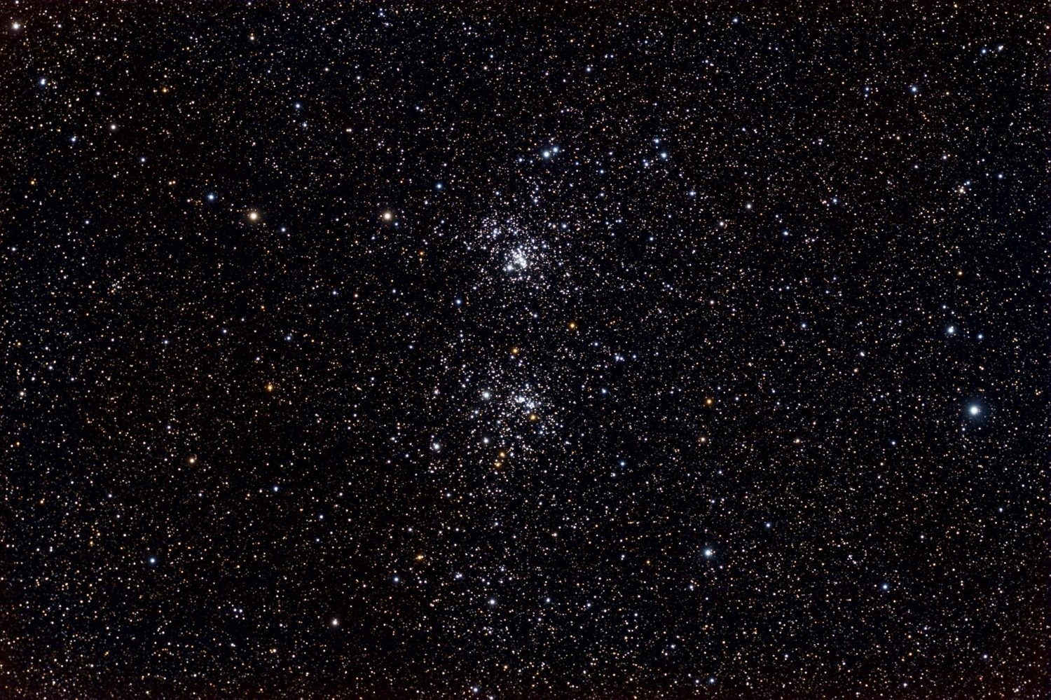Caldwell 14 - The Double Cluster taken by /u/ItFrightensMe, https://en.wikipedia.org/wiki/Double_Cluster#/media/File:Double_Cluster.jpg, CC BY-SA 3.0