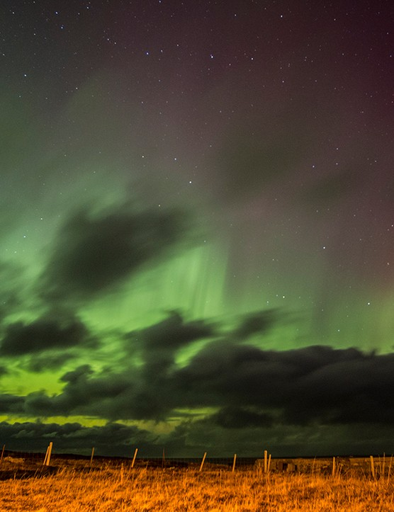 Aurora over Durness Cairn Andy Walker, Durness, UK. Equipment: Canon EOS 70D DSLR camera, Sigma 15-30mm EX DG HSM lens.