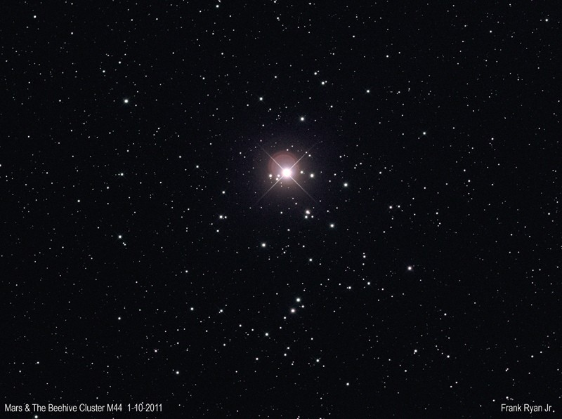 Mars-in-the-centre-of-the-Beehive-Cluster-M44-1st-Oct-2011.-18c7f66