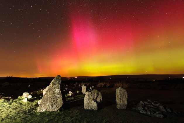 In Northern Ireland, Martin McKenna captured vivid naked-eye reds, greens and oranges with 80º high rays from the Beaghmore stone circle. Credit: Martin McKenna/Spaceweather.com