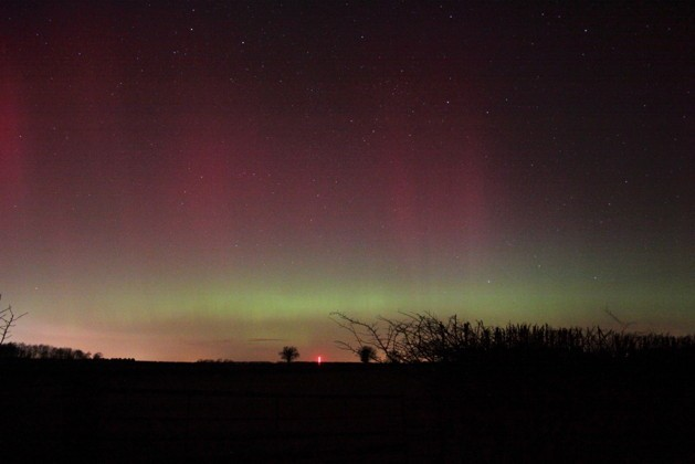 Paul Money witnessed green veils with diffuse red aurora above along the northern horizon from Lincolnshire. Credit: Paul Money