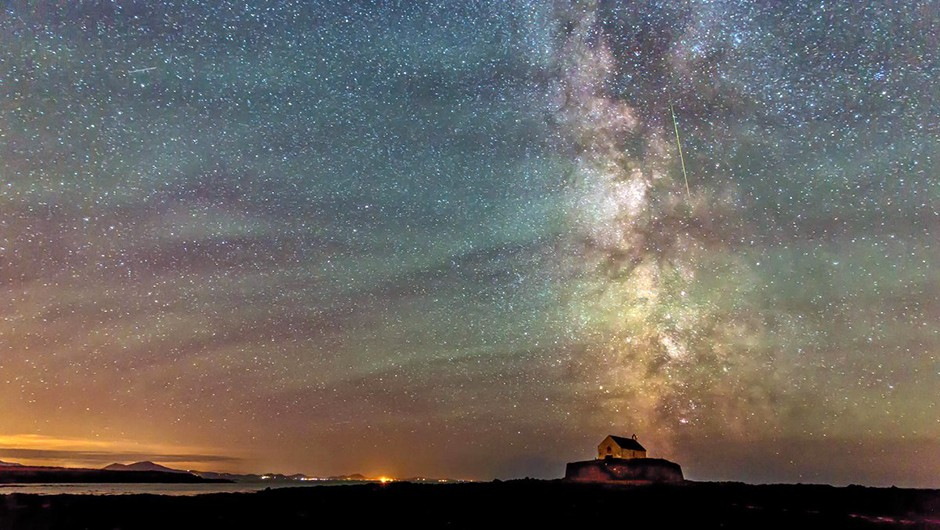 Kevin Lewis composed a beautiful image of the Milky Way over St. Cwyfan Church on the island of Anglesey, and managed to also capture a Perseid in the frame! Kevin used a Canon EOS 5D Mark III DSLR camera and 24-70mm lens. Credit: Kevin Lewis.