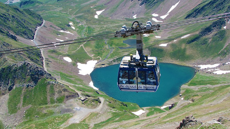 The regular way up to the Pic du Midi is by a two-stage cable car that takes 15 minutes Credit: Pic du Midi