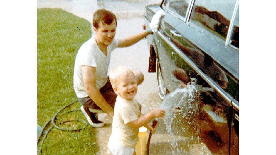 """Jack washing his Volvo with his son in 1971 while living near Johnson Space Center in Houston, Texas. """"This is the car I almost totaled on the day of the Apollo 11 Moon landing"""" Credit: Jack Clemons"""