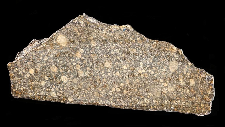 A small slice of the Beddgelert meteorite is on display at the National Museum of Wales in Cardiff, along with a model of the smaller Pontllyfni meteorite. In this image the scale bar is in millimetres and the specimen number is NMW 50.514.GR.1. Copyright: The National Museum of Wales