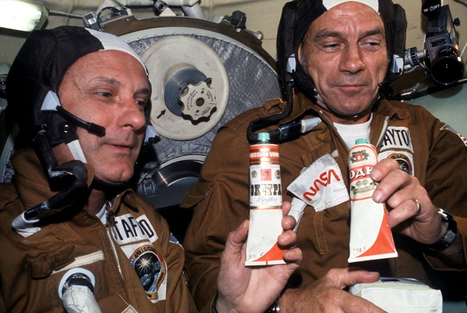 The 1975 Apollo-Soyuz Test Project saw US astronauts and Soviet cosmonauts dock their spacecraft together, in a symbolic show of cooperation at the height of the Cold War. Here, NASA astronauts Thomas P. Stafford (left) and Deke Slayton hold containers of borscht (beetroot soup), gifted by Soviet cosmonauts. Vodka labels were pasted on the tubes so that the astronauts could toast one another. Credit: NASA