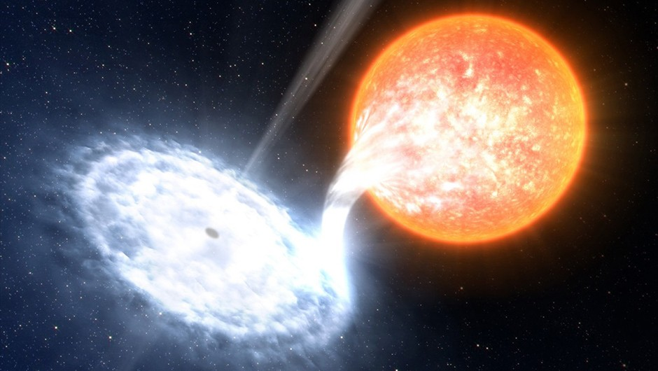Radiation emanating from accretion discs is one way we can infer that a black hole exists. Credit: ESO/L. Calçada