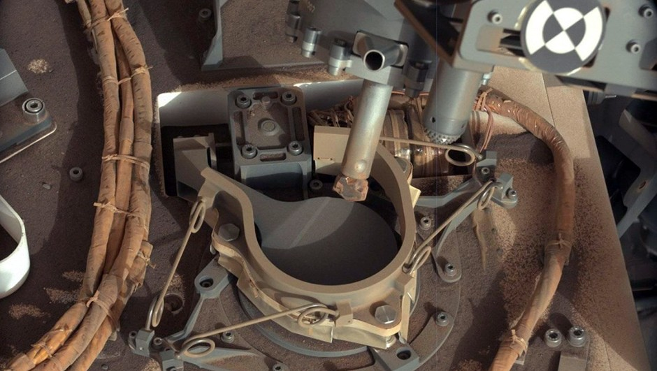 An image of the drill bit on the Curiosity rover, positioned over one of the sample inlets on the rover's deck. The inlets lead to Curiosity's onboard laboratories. Image credit: NASA/JPL-Caltech/MSSS
