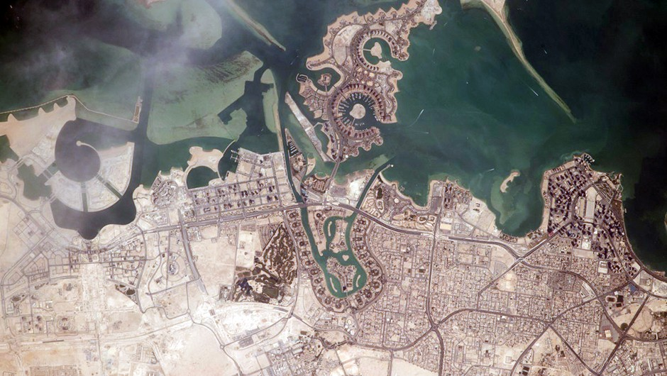 An image of Doha, the capital city of Qatar, in a photo taken from the International Space Station. Spaceflight has also allowed us to look back on our own planet and see humanity's effect on the landscape. Credit: NASA
