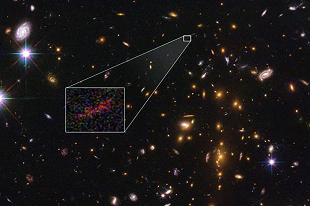 An image showing the farthest galaxy ever observed using gravitational lensing. Credits: NASA , ESA, and B. Salmon (STScI)