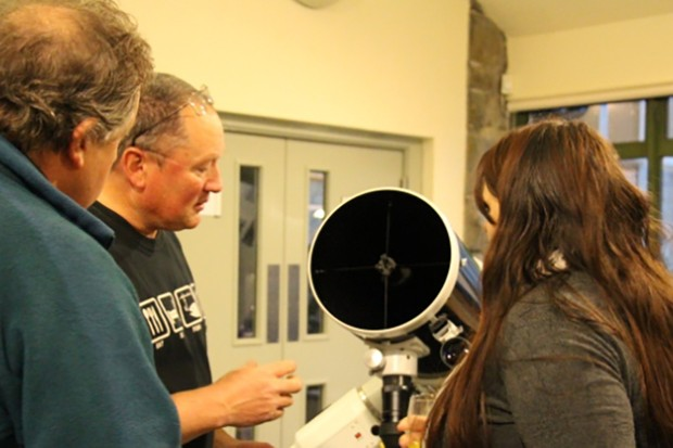 Roger Poole shows off his telescope, but in the evening the clouds cleared, the telescopes were moved outside and visitors were treated to the wonders of what a truly dark sky can offer. Image Credit: Elizabeth Pearson
