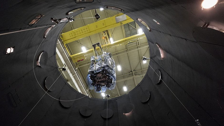 The Parker Solar Probe is lowered into the thermal vacuum chamber that simulates the harsh conditions the spacecraft will face on its journey through space. Credit: NASA/JHUAPL/Ed Whitman