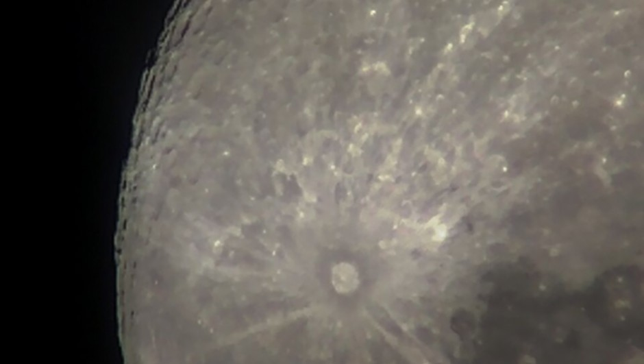 This image of Tyco Crater on the Moon was taken using an iPhone through a 4-inch telescope