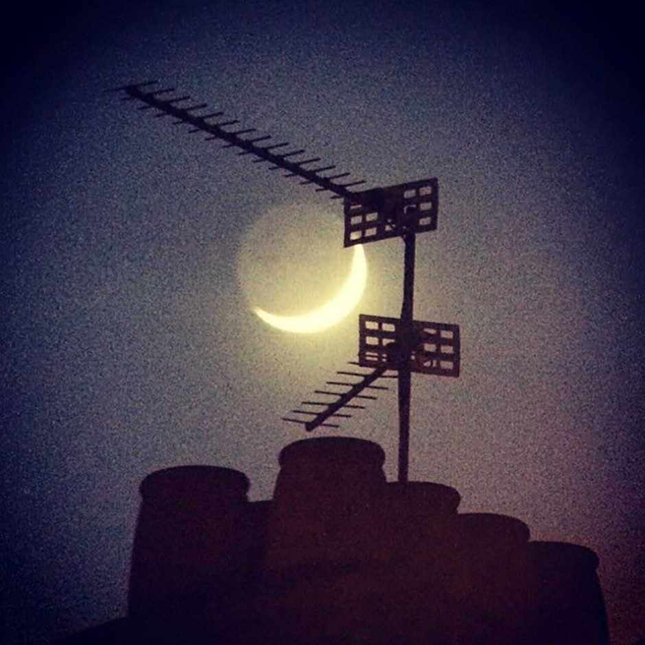 A Crescent Moon and Earth-shine through 10x70 binoculars, put through an Instagram filter