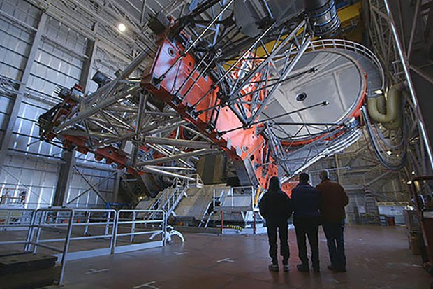Roger Griffin, Donald Lynden-Bell and Nick Woolf stand before the Large Binocular Telescope