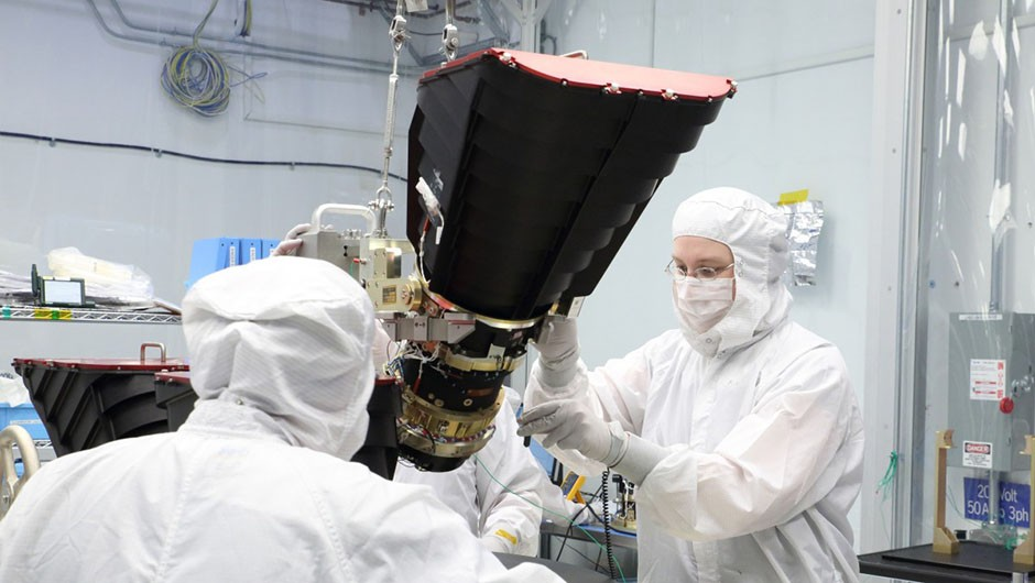 Scientists mount TESS's cameras onto a camera plate at Orbital ATK in Dulles, Virginia, US, prior to its installation onto the spacecraft. Credit: Orbital ATK