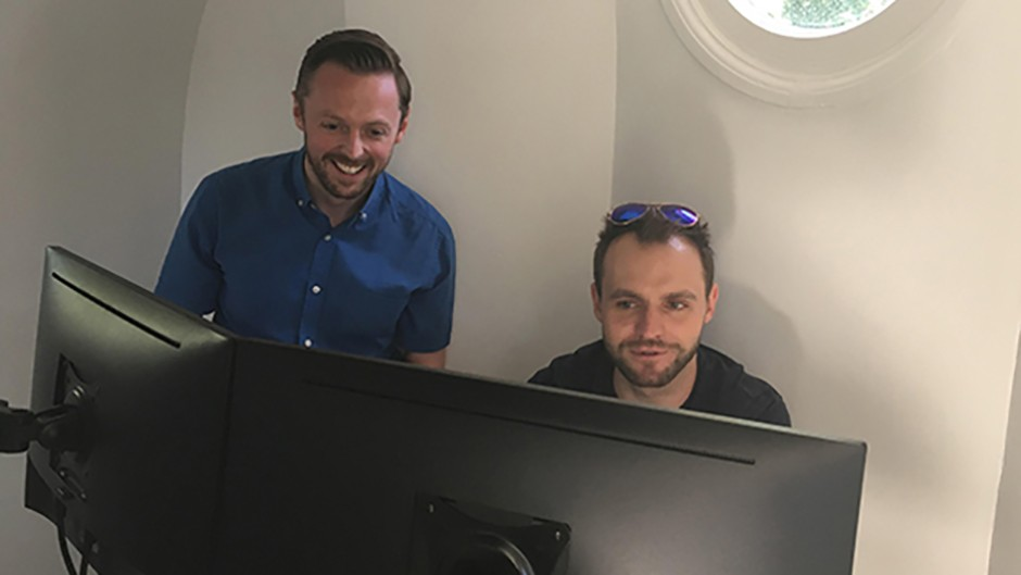 ROG astronomers Brendan Owens (left) and Tom Kerss operating the telescope through a computer. Using stacking techniques and creating mosaics they are able produce detailed images of the Sun and the Moon. Credit: Katherine Shaw / BBC Sky at Night Magazine