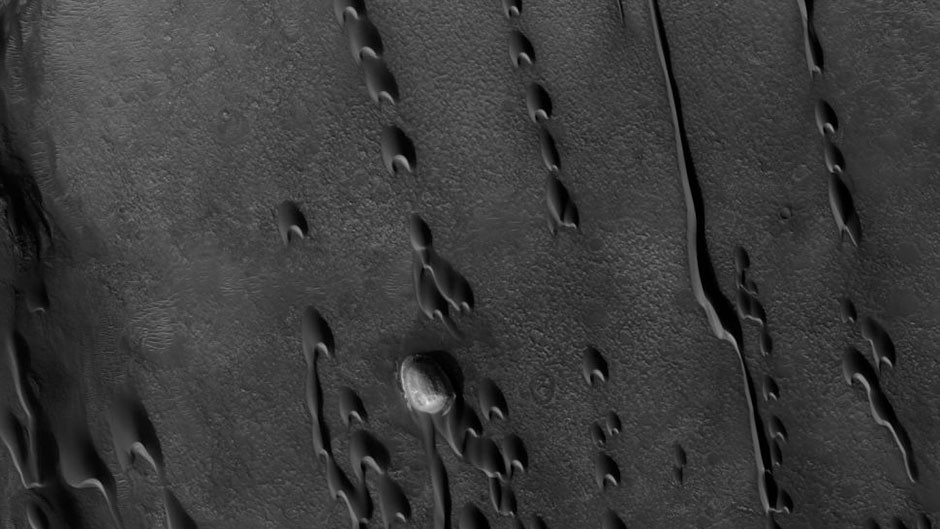 The remnants of sand dunes, seen in satellite images of the surface of Mars.  Studying features like these can reveal the secrets of the Red Planet's environmental history. Credit: NASA/JPL/University of Arizona