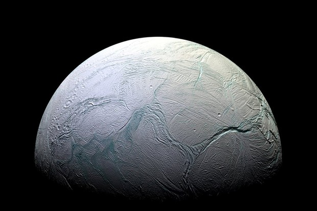 Enceladus's cratered crust, as seen by the Cassini spacecraft. What lies below, in the moon's subsurface ocean? Image Credit: NASA/JPL-Caltech/Space Science Institute