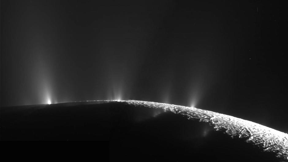 An image of Enceladus captured by Cassini, showing plumes of vapour bursting through Enceladus's icy crust. Credit: NASA/JPL-Caltech/SSI