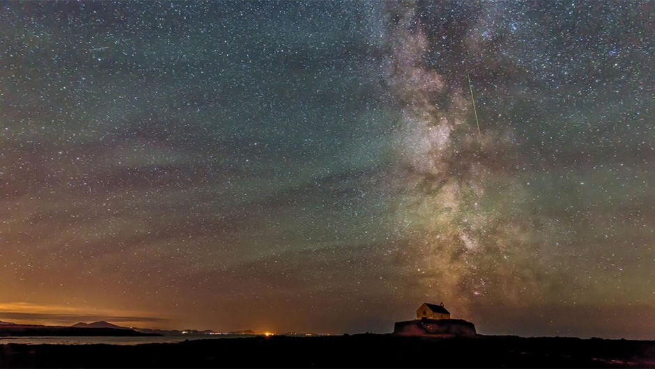 Kevin Lewis was imaging the sky above the 'church in the sea' on the Isle of Anglesey in August last year when he managed to capture a Perseid overhead, seen as a vertical streak above right of centre. This image was taken with a Canon EOS 5D Mk III DSLR camera and 24-70mm lens.Credit: K. Lewis