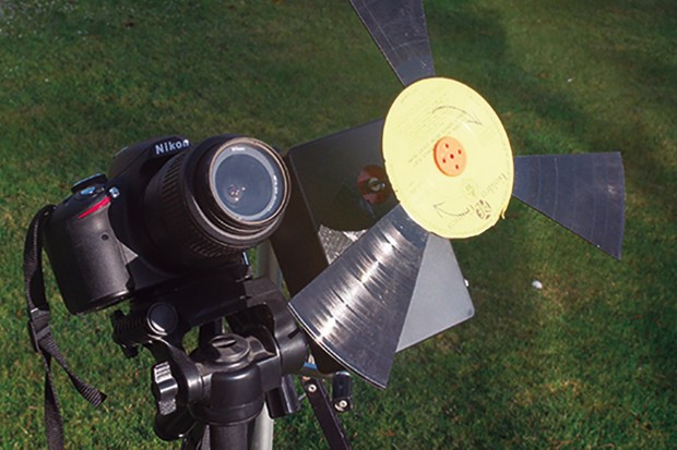 The completed shutter mounted on its own tripod and positioned beside a camera. Image Credit: Mark Parrish