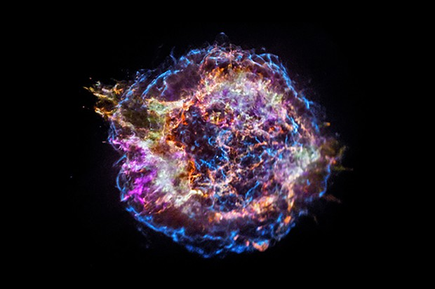 This image from NASA's Chandra X-ray Observatory shows the location of different elements in the Cassiopeia A supernova remnant including silicon (red), sulfur (yellow), calcium (green) and iron (purple). Each of these elements produces X-rays within narrow energy ranges, allowing maps of their location to be created. The blast wave from the explosion is seen as the blue outer ring. Astronomers study supernova remnants to better understand how stars produce and then disseminate many of the elements on Earth and in the cosmos at large.