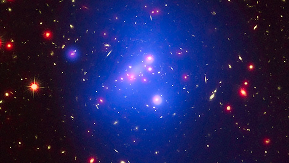 Astronomers have made the most detailed study yet of an extremely massive young galaxy cluster using three of NASA's Great Observatories. This multi-wavelength image shows this galaxy cluster, IDCS 1426.5+3508, in X-rays from Chandra (blue), visible light from Hubble (green), and infrared light from Spitzer (red). This rare galaxy cluster weighs almost 500 trillion Suns and it was observed when the Universe was less than a third of its current age. It is the most massive galaxy cluster detected at such an early epoch, and, thus, has important implications for understanding how these mega-structures formed and evolved in the young Universe.