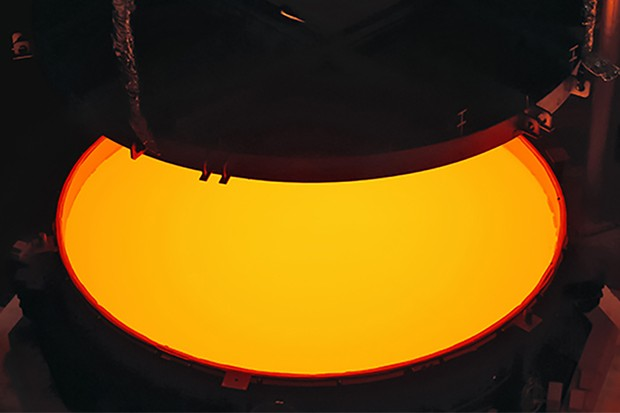 Opening of the ELT M2 ZERODUR® blank mould containing the still very hot ZERODUR® glass at first annealing at the SCHOTT 4-metre blank annealing facility in Mainz, Germany in May 2017. The completed mirror will be 4.2 metres in diameter and weigh 3.5 tonnes. It will be the largest secondary mirror ever employed on a telescope and also the largest convex mirror ever produced.