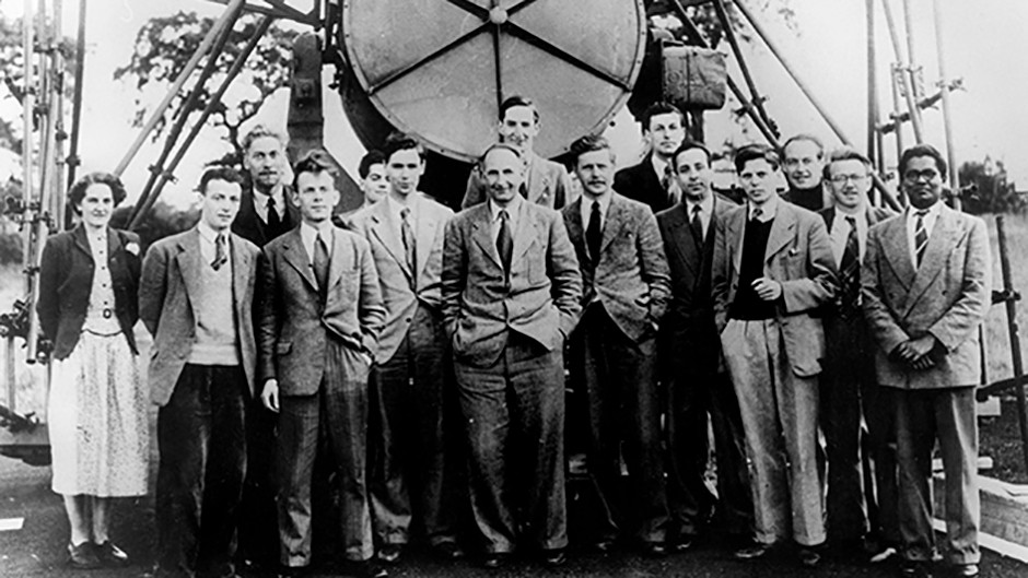 Sir Bernard Lovell (centre) and the Jodrell Bank Observatory team in front of the Searchlight Aerial in 1951 Credit: The University of Manchester