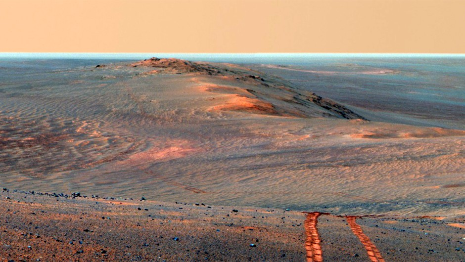 A dramatic Martian landscape captured by Opportunity as it looked back towards part of the west rim of Endeavour Crater during the summer of 2014. Credit: NASA/JPL-Caltech/Cornell/ASU