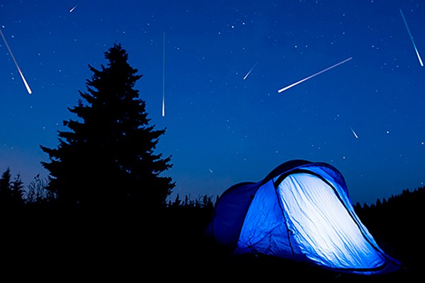 Summer camping trips can be a great time to spot some meteors under dark, rural skies. Credit: iStock