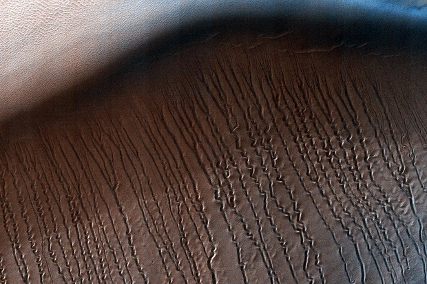 Hellas Planitia is the largest visible impact basin in the Solar System. This image from NASA's Mars Reconnaisance Orbiter (MRO) covers a small central portion of the basin and shows a dune field with lots of dust devil trails. Image Credit: NASA / JPL
