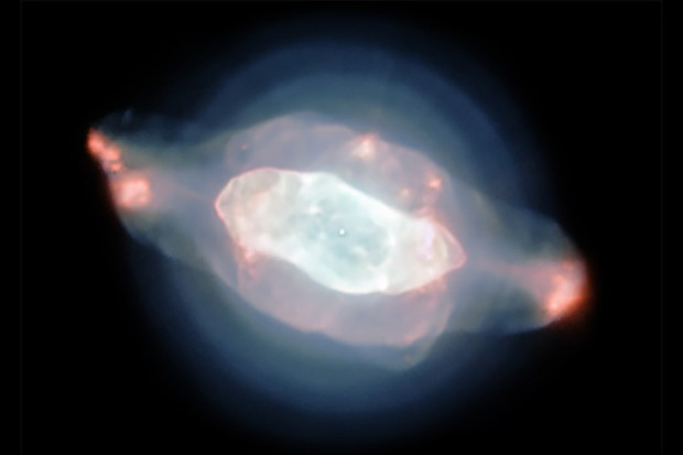Planetary nebula NGC 7009, or the Saturn Nebula, glows pink and blue. These observations with the Very Large Telescope have been used to create the first detailed optical maps of gas and dust distributed throughout a planetary nebula. Credit: ESO/J. Walsh