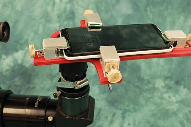 Plumbing fittings and bespoke clamps attach your mobile to your scope. Image Credit: Mark Parrish