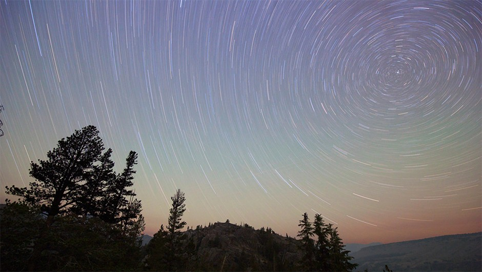 Star trails form circles in the northern sky behind Rosalie Lake along the John Muir Trail