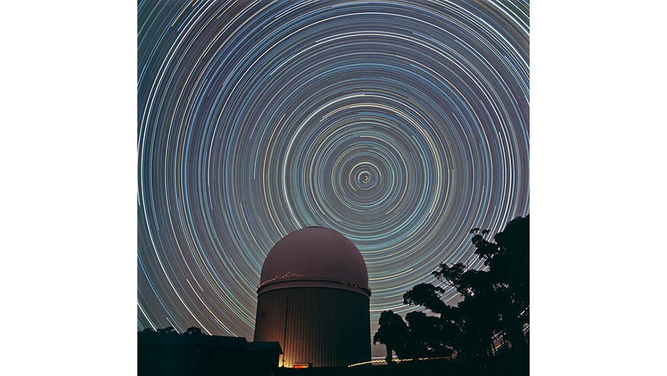 Star trails around the South Celestial Pole, AAT dome in foreground.Scanned from original 6 x cm Ektachrome transparency by dfm March 2009.