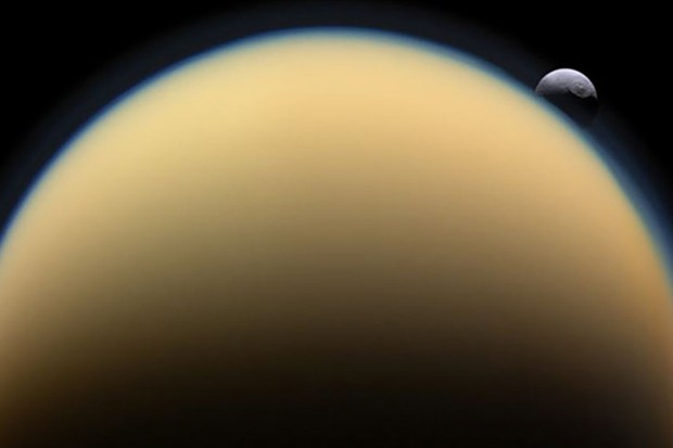 Like Earth, Titan has an atmosphere, seen here as a hazy blue outline around the moon's limb. But Cassini scientists have discovered another similarity between our planet and Saturn's largest moon.To the upper left of Titan in this image taken by the Cassini spacecraft is Tethys, another of Saturn's satellites.Credit: Cassini Imaging Team, ISS, JPL, ESA, NASA